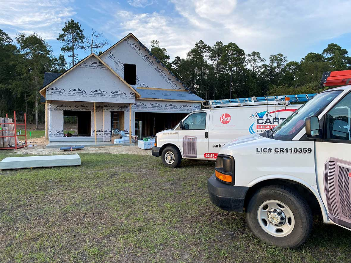 Air conditioning being installed in a new construction home